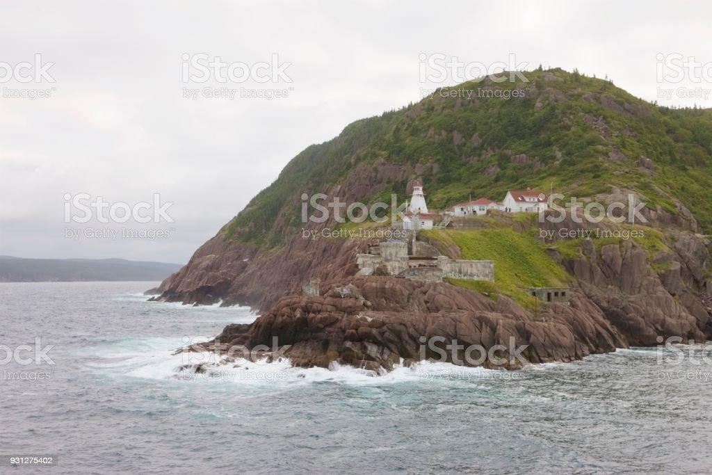 Newfoundland harbor lighthouse stock photo