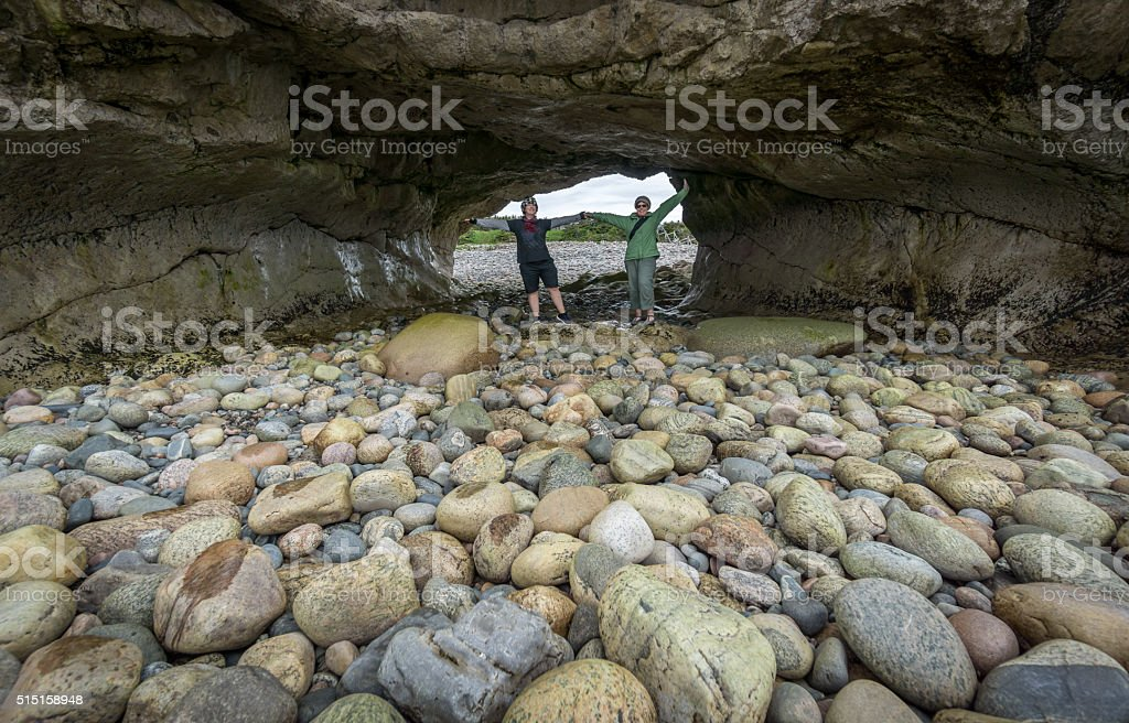 Newfoundland Tourists Pose at The Arches Provincial Park stock photo