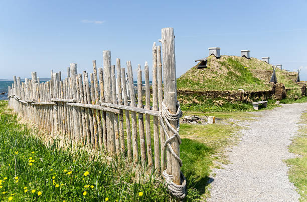 Newfoundland Viking Dwellings and Fence Newfoundland, Canada, 28 June, 2015: External view of a replica Viking dwelling at L' anse aux Meadows, Norstead Village, in Newfoundland, Canada. st. anthony of padua stock pictures, royalty-free photos & images