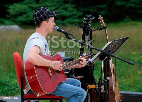 458694311 istock photo Newfoundlander with Red Guitar 458092447