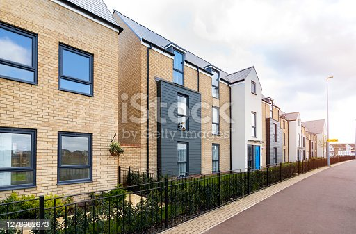 istock Newly built 3 story apartment and homes estate 1278662673