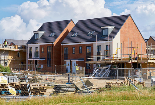Newly built homes in a residential estate in England taken from public land.