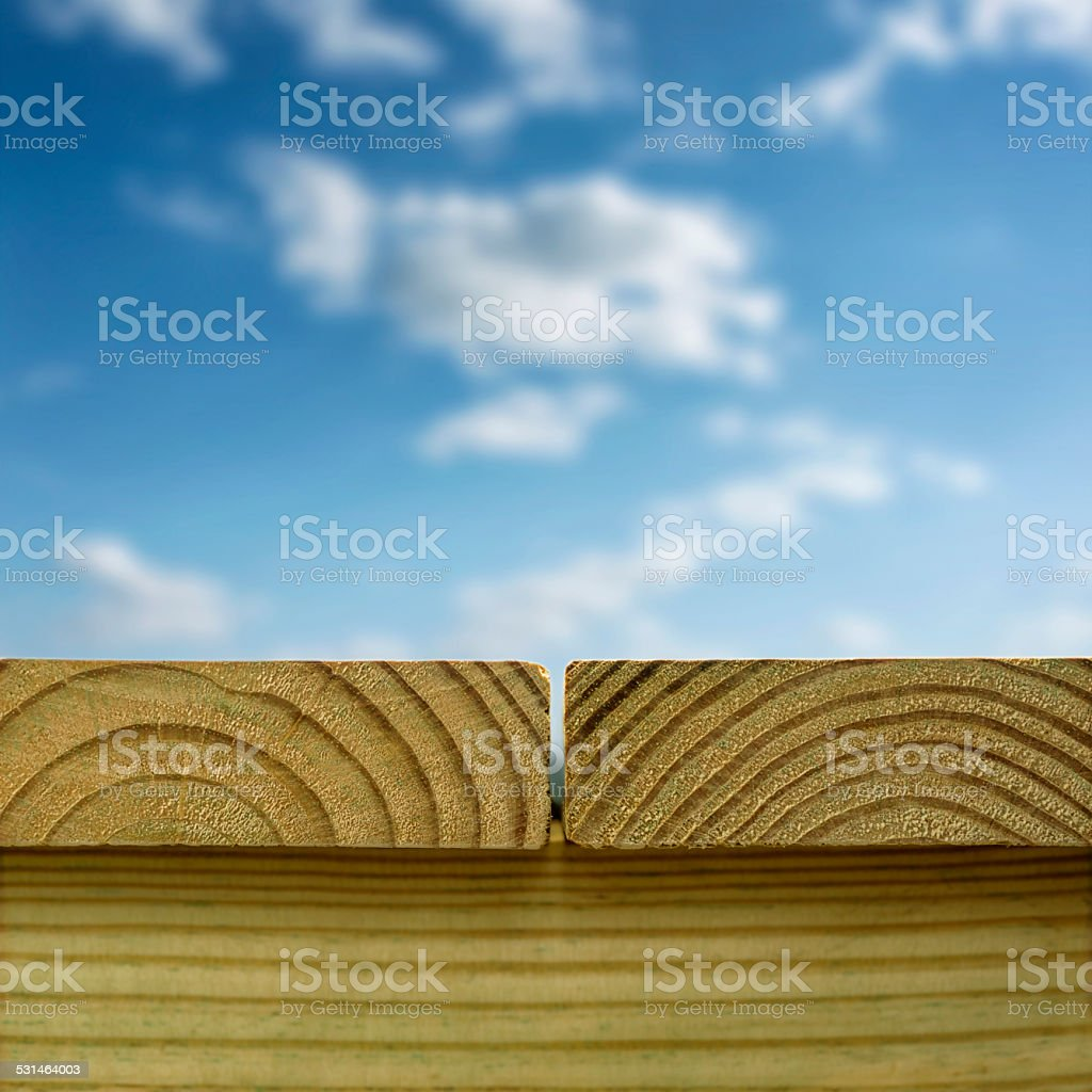 Newly constructed Pressure Treated deck against a partly cloudy sky stock photo