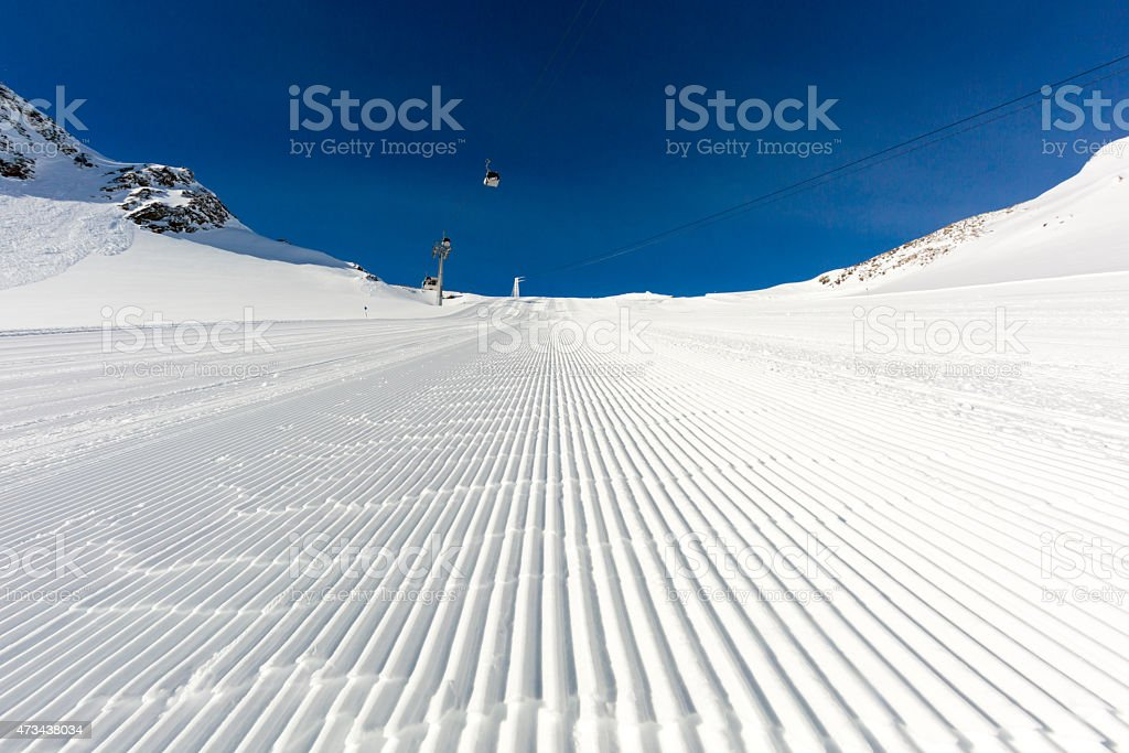 Newly groomed ski slope on a sunny day stock photo