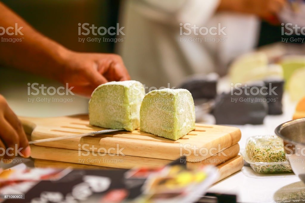 Newly made bread from the oven. Put on a wooden plan. Prepare to serve customers. stock photo