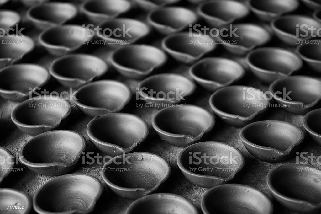 Newly made Butter lamps drying in Nepal. stock photo