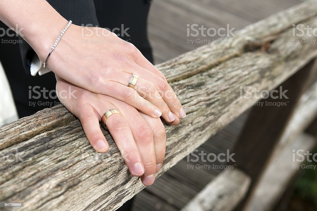newly married couple showing their wedding rings stock photo
