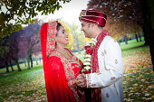 istock Newly married Indian couple embracing in the serene parkland 456874503