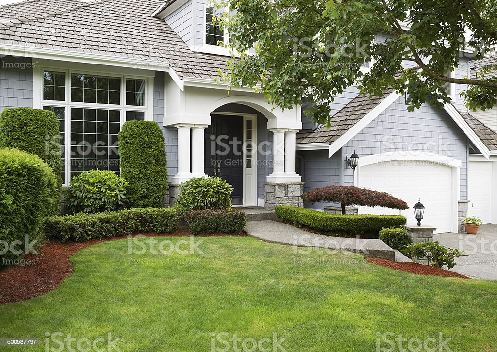 Newly painted and stained exterior of modern home during summert stock photo