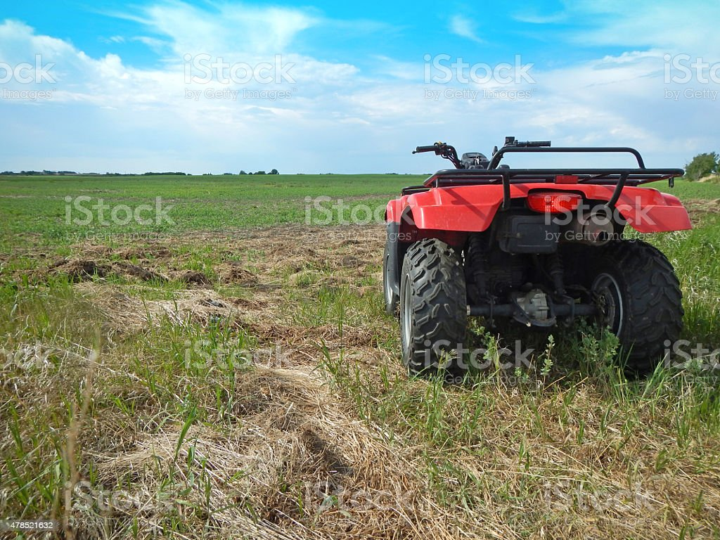 Newly planted grain crop and farmer's Quad stock photo