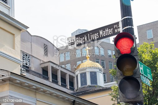 A newly installed street sign bears the new name of Black Lives Matter Plaza NW. The two-block stretch of 16th Street NW in front of the White House in Washington, D.C. is also painted with