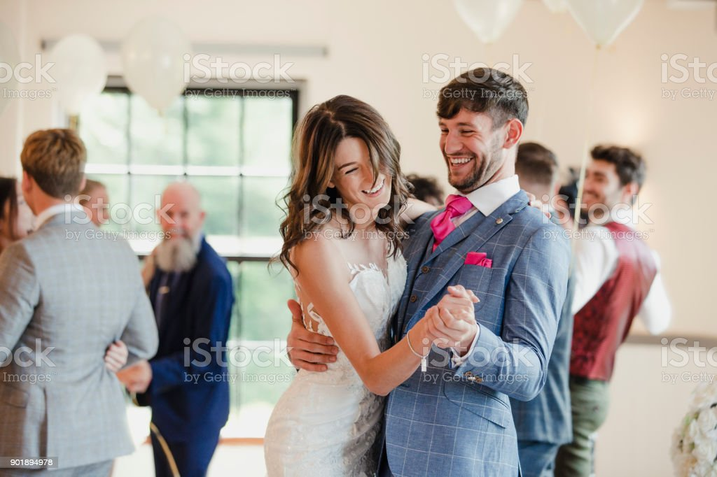 Newly Wed Couple Dancing With Their Guests stock photo