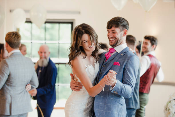 Newly Wed Couple Dancing With Their Guests Newly wed couple are dancing together on their wedding day with all of their guests. bridegroom stock pictures, royalty-free photos & images