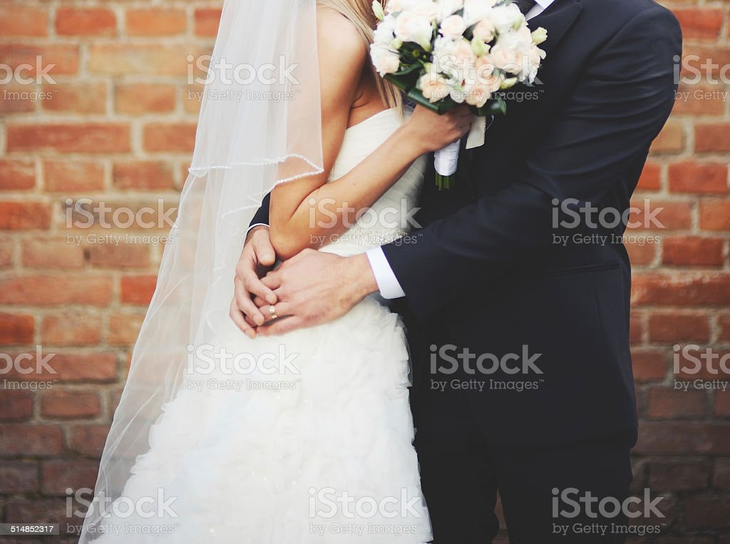 Newly wed couple holding hands. stock photo