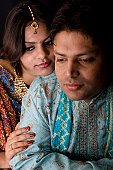 istock Newly Wed Indian Asian Couple vertical dark portrait 116424038