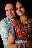 istock Newly Wed Indian Asian Couple vertical dark portrait 116424071