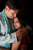 istock Newly Wed Indian Asian traditional Couple vertical dark portrait 172701992