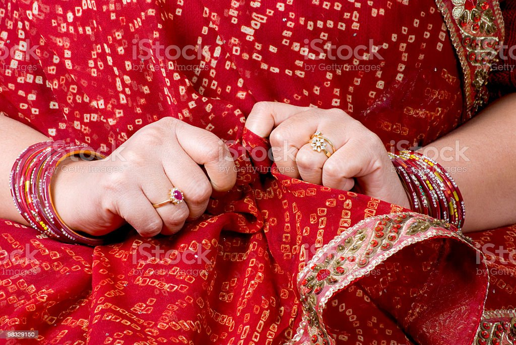 newly wed shy women wearing red bandhej sari - bangles royalty-free stock photo