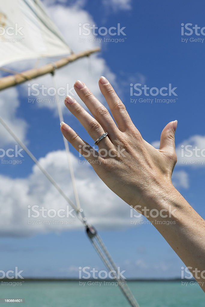 Newly Wed Woman Hand on Dugout Canoe in Tropical Paradise royalty-free stock photo