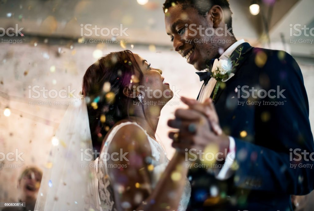 Newlywed african descent couple dancing wedding celebration stock photo
