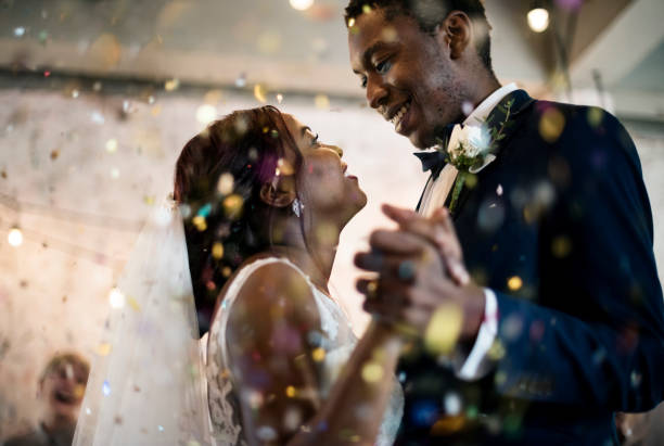 newlywed african descent couple dancing wedding celebration - wedding stock pictures, royalty-free photos & images