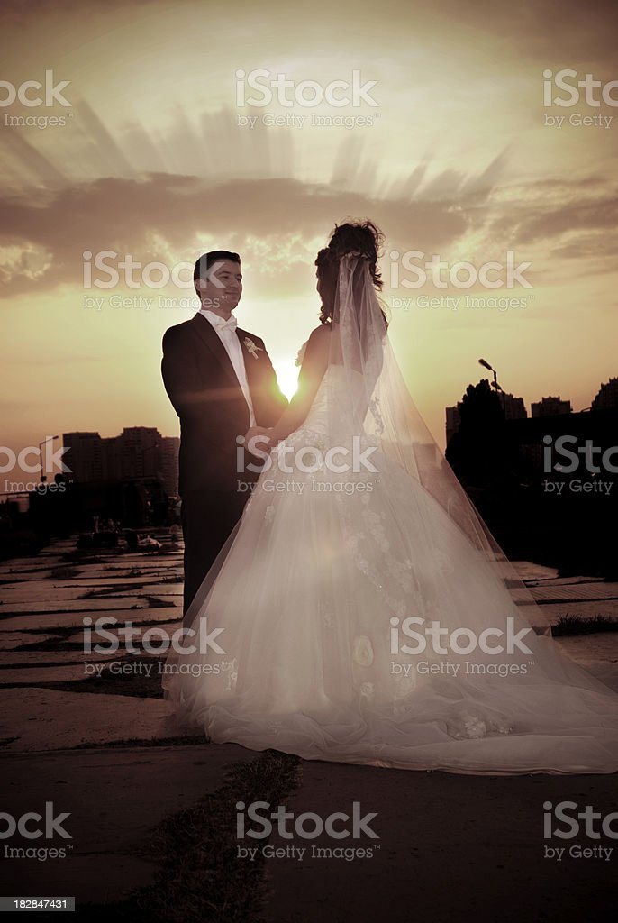 Newlywed couple and sunset royalty-free stock photo