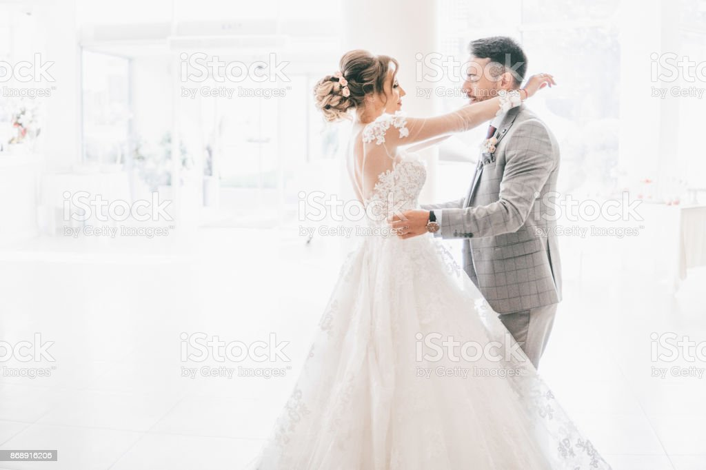 Newlywed couple dancing stock photo