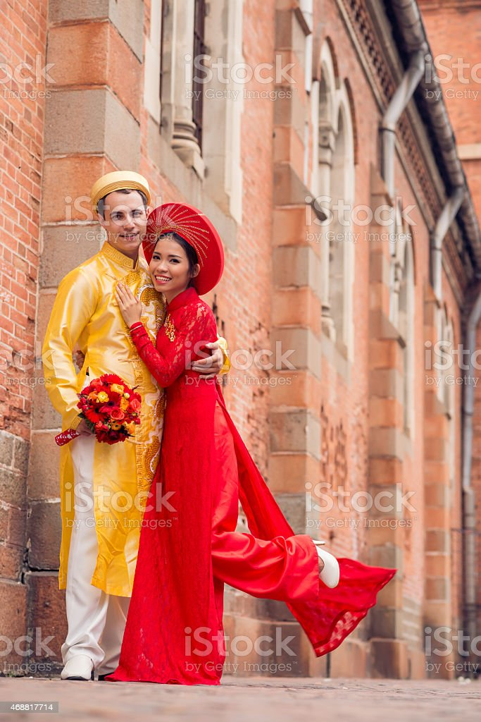 Newlywed couple in  ao-dai dresses stock photo