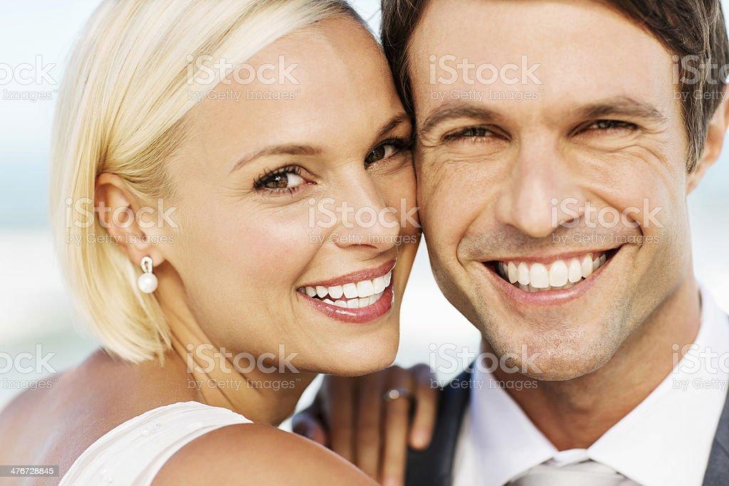 Newlywed Couple Smiling On Beach stock photo
