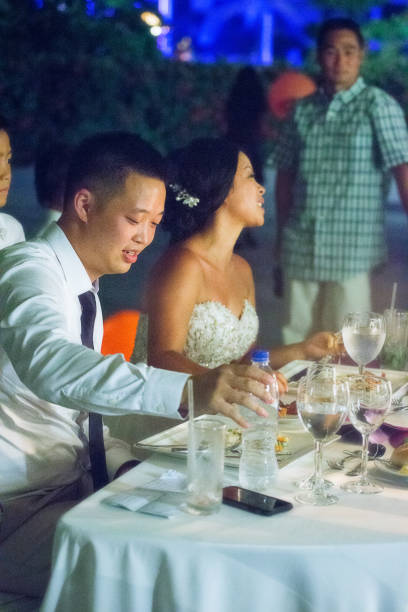 Newlywed eating at reception Bride and groom eating dinner chinese wedding dinner stock pictures, royalty-free photos & images