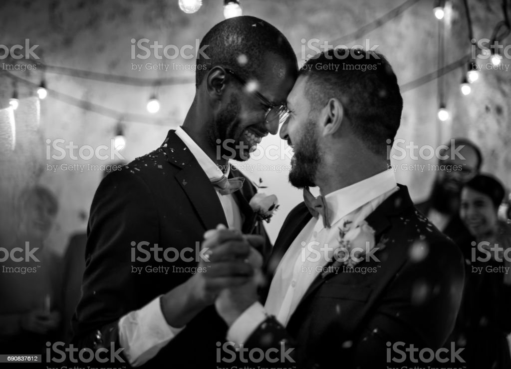 Newlywed Gay Couple Dancing on Wedding Celebration stock photo