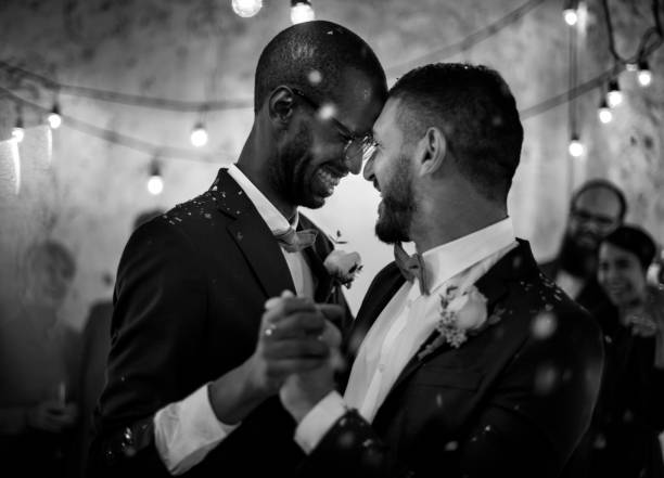 newlywed gay couple dancing on wedding celebration - wedding stock pictures, royalty-free photos & images