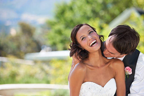 newlywed naughtiness! - kissing on neck stock photos and pictures