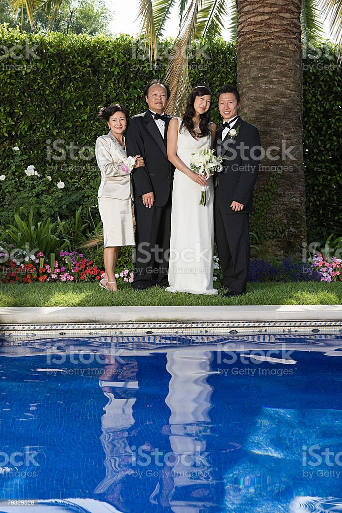 Newlyweds and family 免版稅 stock photo