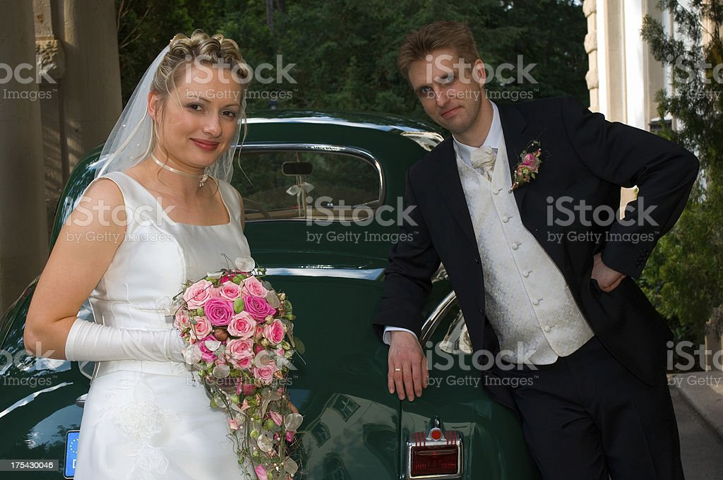 newlyweds and their car royalty-free stock photo