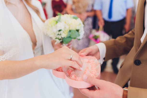 newlyweds append signatures in a registry office during wedding registration. newlyweds append signatures in a registry office during wedding registration append stock pictures, royalty-free photos & images