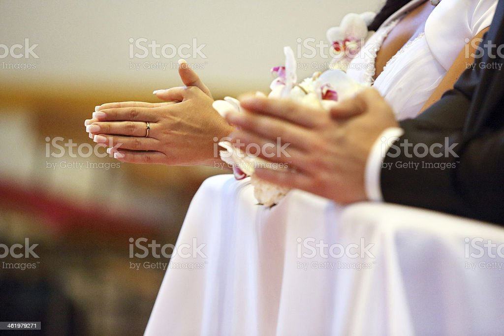 Newlyweds at the catholic church stock photo