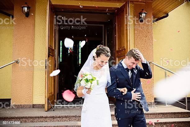 Newlyweds coming out of the church after wedding ceremony picture id531473466?b=1&k=6&m=531473466&s=612x612&h=yalca9soprtwceih43y2 yn2bjdd3iopor9nq jysni=