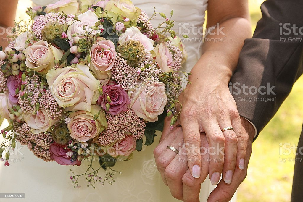 Newlyweds hold hands stock photo