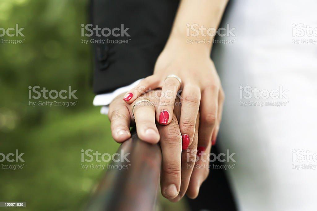 Newlyweds holding hands stock photo