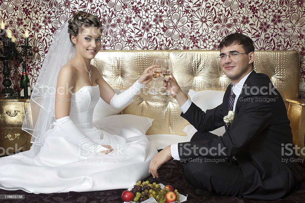 newlyweds in bedroom royalty-free stock photo