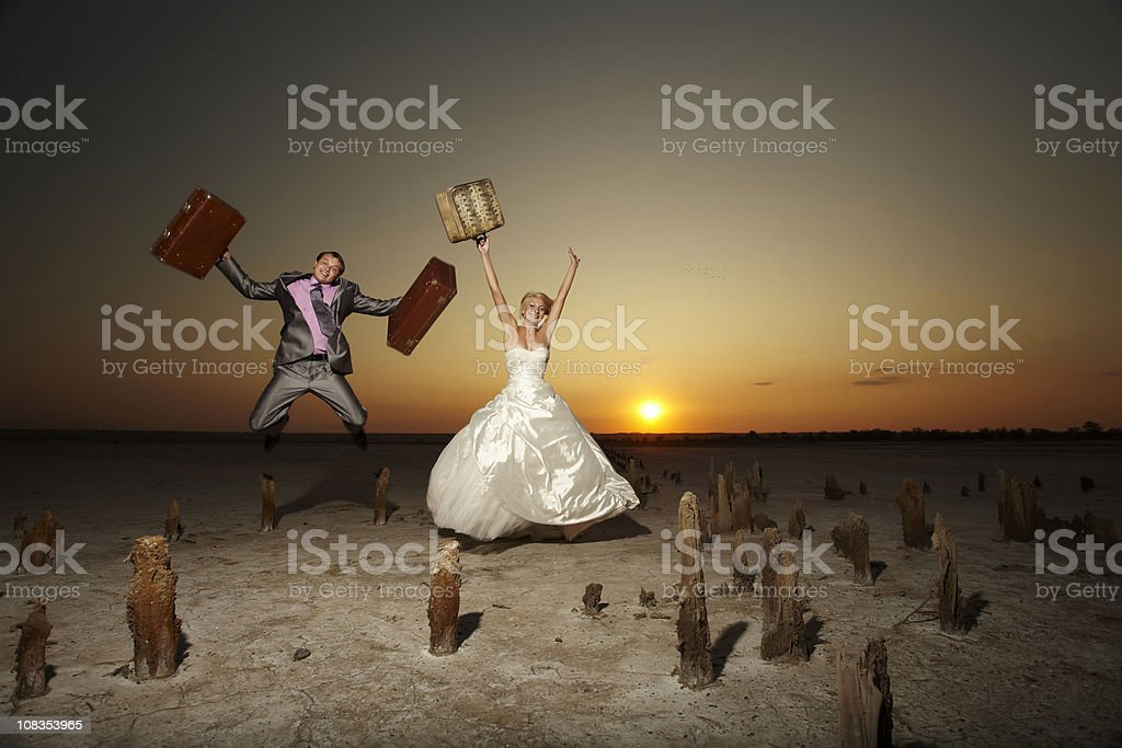 Newly-weds in the desert on sunset. royalty-free stock photo
