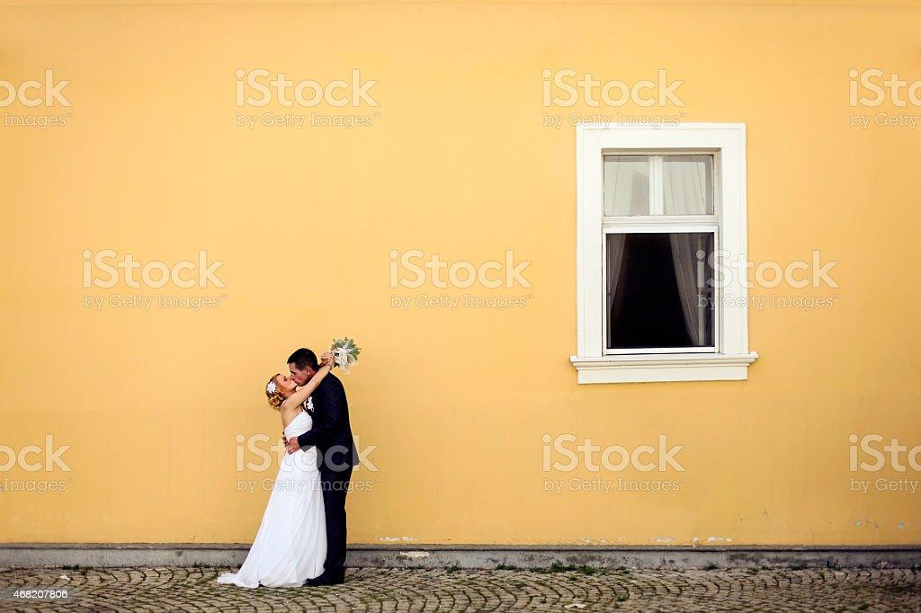 Newlyweds kissing stock photo