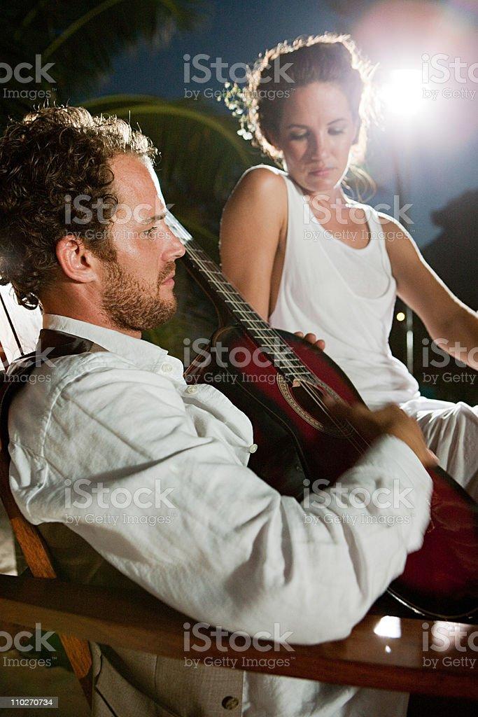 Newlyweds, man playing guitar royalty-free stock photo