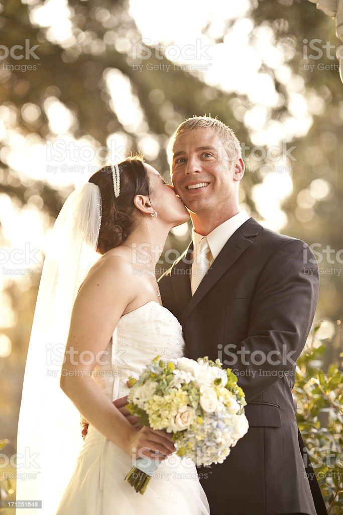Newlyweds Necking and Smiling On Country House Porch Wooded Background. stock photo