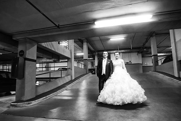 newlyweds standing in garage bw - petticoat stock pictures, royalty-free photos & images