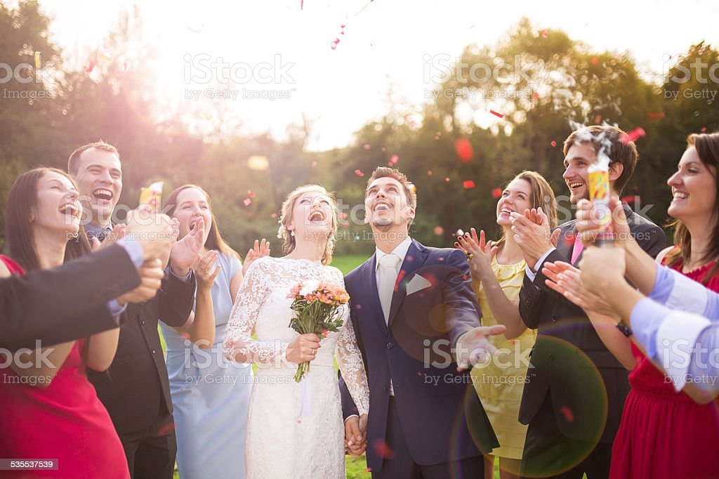 Newlyweds with guest on their garden party royalty-free stock photo