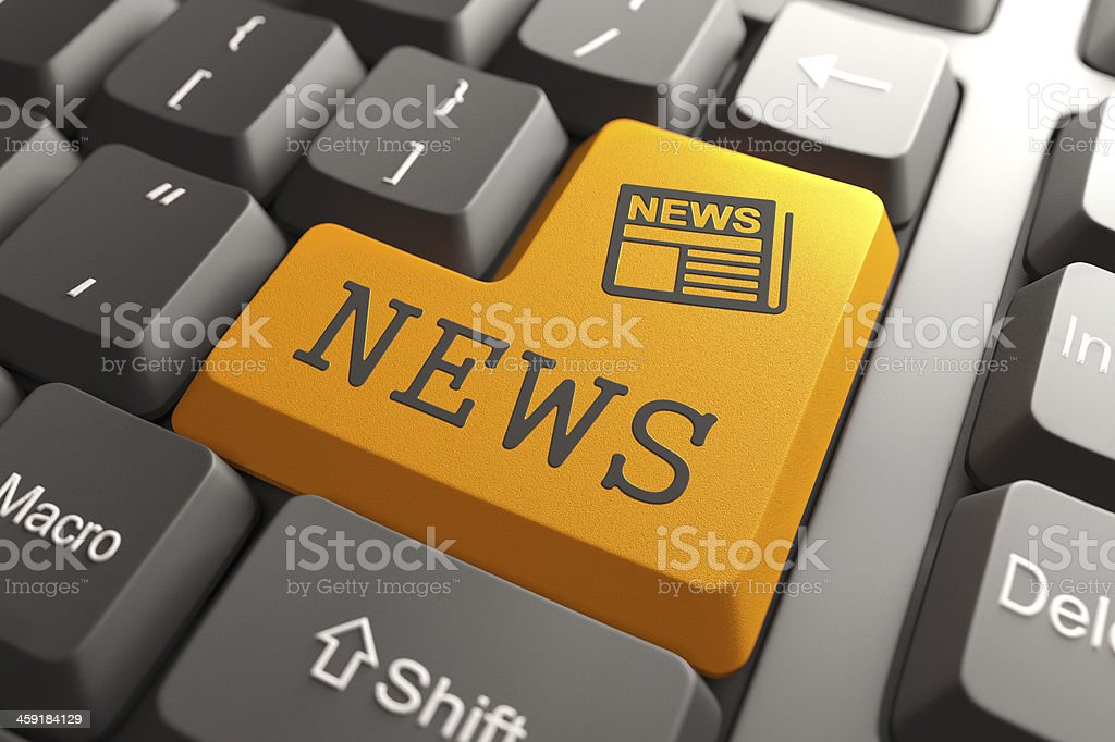 News Concept on Orange Keyboard Button. stock photo