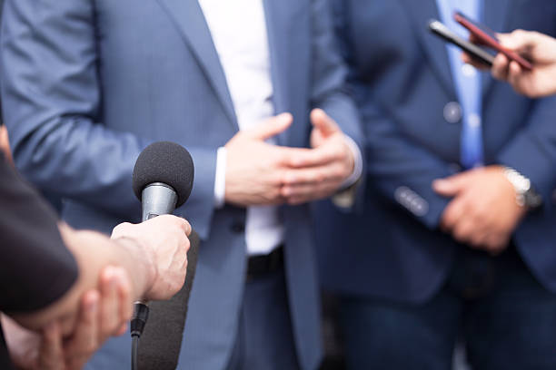 News conference. Media interview. Journalists making interview with businessperson, politician or spokesperson. Press conference. spokesperson stock pictures, royalty-free photos & images