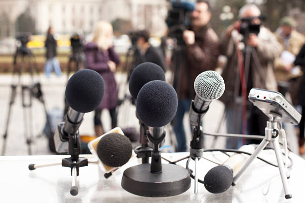News conference Microphones at a news conference. Press conference. press conference stock pictures, royalty-free photos & images